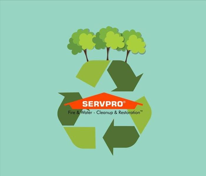 A green background with a recycling symbol and trees above it and the SERVPRO logo in the middle