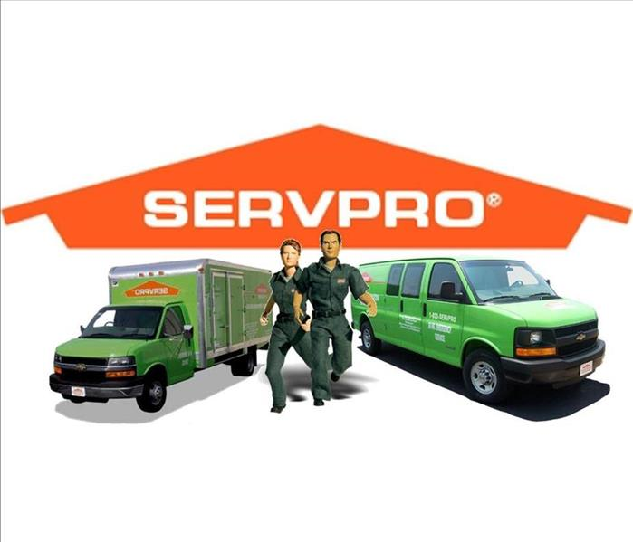 The Orange house SERVPRO logo with a Green van and a box truck in front of it along with a cartoon woman and man