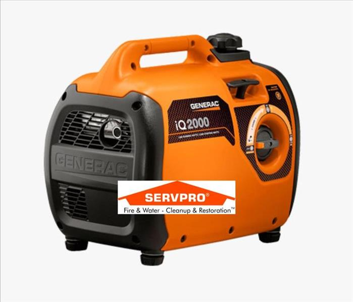 A picture of an orange and black generator with the SERVPRO logo in the middle